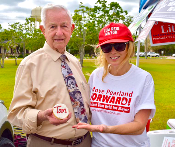 Mayor Tom Reid and Leisha showing off his cookie.png
